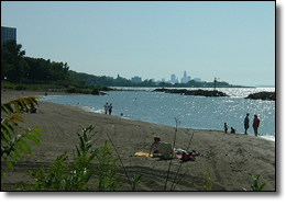 The beach at Euclid Creek provides views of the Downtown skyline.